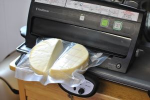 After the cheese has a nicely developed rind (typically 1-2 days) it's time to package it. We use a fancy Foodsaver, because we tried waxing it and it never turned out good, so we bought a Foodsaver, which works great for preserving cheese.