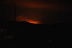 That creepy looking glow outside your window letting you know there's a fire close to home.