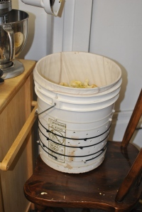 We used a 5 gallon bucket, drilled holes in it, wrapped it with ties (this doesn't allow it to expand under pressure) and we put a paint strainer bag in to easily remove the apples and keep them from getting stuck in the holes.