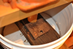Once ready, put a wooden circle that fits the hole on top and start pressing!